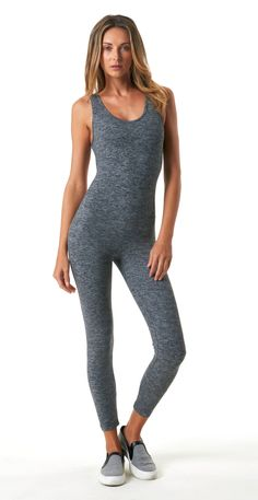 FIT & FEEL Figure forming ankle length jumpsuit Strapped open back detail Soft, heathered, moisture wicking fabric helps protect against harmful UV rays Recommended for medium performance Model wearin