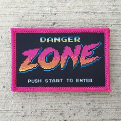 DANGER ZONE Nintendo start screen/Archer mashup patch has been restocked. Only 25 Velcro and 25 iron-on versions available.  #patchgame #patch #patches #patchcommand #goruck #grt #graphicdesign #graphicdesigner #illustrator #illustration #photoshop #8bit #pixel #pixels #pixelart #archer #dangerzone #nintendo #nes #80s #ilovethe80s #popculture #instantclassic #alldayruckoff #topgun #goodtype #typography #nintendolife #design by scottdmartin
