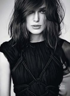 Keira's dark mid length cut with texture and tons of sex appeal.