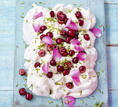 Cherry, rose & pistachio Pavlova traybake. Take this retro meringue dessert to another level by adding edible flower petals, coconut cream, fruit and nuts for even more texture