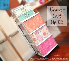 Line fronts of drawer cart with scrapbook paper and double sided tape to hide the stuff inside