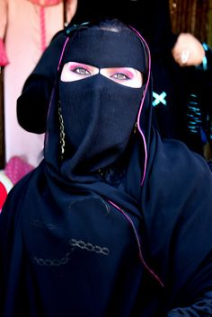 Lady wearing mask called a Naqab - Al Ain, Abu Dhabi, United Arab Emirates