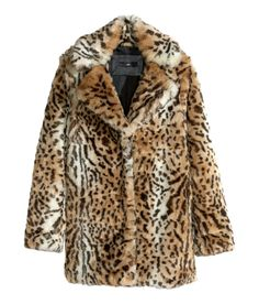 Unleash your wild side with this leopard-print faux fur jacket.   Warm in H&M
