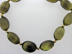 Smokey quartz and gold necklace, part of our new Winter collection! Smokey Quartz, Gold Necklace, Sunglasses, Winter, Christmas, Collection, Winter Time, Xmas, Gold Pendant Necklace