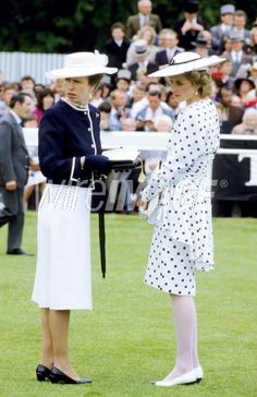 What is going on? Princess Diana and Princess Anne  look befuddled in this photograph.  Enjoy RUSHWORLD boards, DIANA PRINCESS OF WALES EXTENSIVE PHOTO ARCHIVE, UNPREDICTABLE WOMEN HAUTE COUTURE and WEDDING GOWN HOUND. Follow RUSHWORLD! We're on the hunt for everything you'll love!