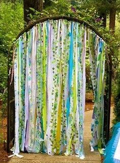 Rustic Fairy garden curtains created from vintage fabrics are with assorted lace, pom poms, purple, green and aqua, Frayed and tattered vintage fabrics fill this enchanted forest ribbon curtain. green,blue,aqua,purple,lime green and more, This would also make an adorable photo backdrop for any event, a wedding, shower, birthday,anniversary, baby photos, dorms, party, Nursery, faerie garden art hand tied repurposed and recycled fabric strips attached to jute cord with 18 on each end for…
