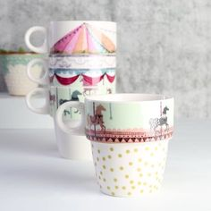 Lisa Angel . Disaster Designs . Merry go round inspired stacking cups . { how super cute are these . would look gorgeous on the kitchen shelf } .