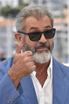 """Mel Gibson Photos - US actor Mel Gibson gives the thumbs-up on May 21, 2016 during a photocall for the film """"Blood Father"""" at the 69th Cannes Film Festival in Cannes, southern France.  / AFP / LOIC VENANCE - 'The Salesman (Forushande)' Photocall - The 69th Annual Cannes Film Festival"""