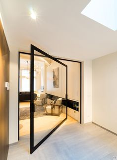 Modern glass pivoting doors made-to-measure with innovative hinges | Anyway Doors