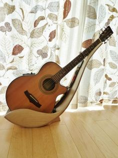 Wooden Guitar Stand by Tom Norrington I want one for my ukulele! Guitar Hanger, Guitar Rack, Cool Guitar, Guitar Storage, Guitar Display, Wooden Guitar Stand, Music Stand, Guitar Accessories, Guitar Building