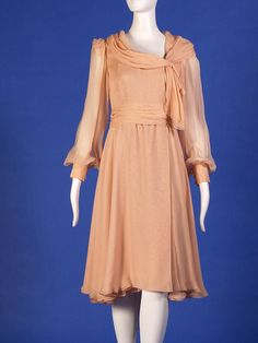 1973-1976 - Peach silk chiffon dress by George Stavropoulos