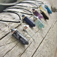 Choose from 23 pendants! Your choice of crystal point pendant on either a leather cord or a silver chain necklace. SELECT COLOR: (as shown in order of