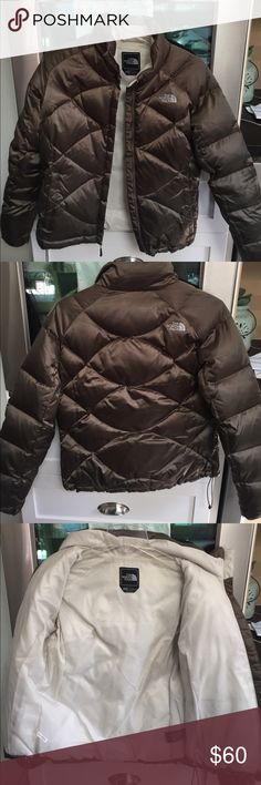 North face ACONCAGUA down coat You will never be cold in this coat! Warm and lightweight down.  Quality north face product.  Olive/brown color.  Perfect condition with zero stains. Be ready for winter with this! North Face Jackets & Coats Puffers