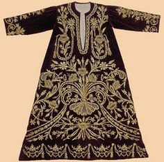 Antique Turkish Textile. A Woman's Kaftan worn at Court. The dark red silk velvet is embroidered with gold thread strip and sequins in dival work and in stem stitch. The pattern is 'Shah's pleasure'.