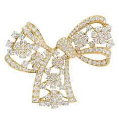 Gold and Diamond Bow Clip-Brooch 18 kt., the openwork looped diamond-set bow accented by diamond-set florets, totaling 173 round diamonds approximately 11.85 cts., approximately 19.2 dwt.