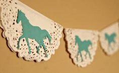 Homemade Doily Garland - I have a niece who would go ga-ga over the horses!