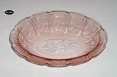 PATTERN NAME: CHERRY BLOSSOM CATAGORY: DEPRESSION MANUFACTURER: JEANNETTE YEARS MADE: 1930 - 1939 PRIMARY COLORS: Green, Pink OTHER COLORS: Crystal, Delphite (blue milk glass), Jadite, Red