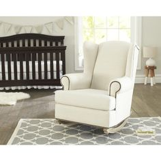 You will love spending time with your baby in the luxurious comfort of Shermag Deluxe McKinley Upholstered Rocker. Shermag's Deluxe Rocking Chair has nursing mothers needs in mind. The padded head rest is extra supportive, and the winged back and deluxe padded armrests offer more shoulder and elbow space. It's carefully crafted with a solid hardwood frame. The antiqued oversize nail head trim adds to the warmth of this chair and will coordinate in any room in the house.<br><br>The Shermag…