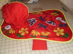 Here's a custom-made Rip-Stop Nylon Dog Raincoat Coat. It is applique , and is lined with flannel. I made it for a craft-swap.