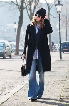 Pair a long coat with floor-grazing flares and heels boots to appear taller