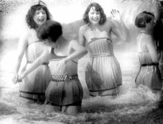 """1929  - wooden bathing costumes  """"""""Spruce Girls"""" on beach wearing spruce wood veneer bathing suits during """"Wood Week"""" to promote products of the Gray Harbor lumber industry, Hoquiam, Washington"""""""