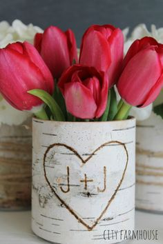 To make these delightful vases, simply glue birch bark onto empty tin cans of matching height.