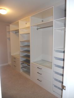My killer closet. IKEA PAX system. Still needs trim and crown.