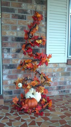 turn an old broken tomato cage upside down & wrap some twig roping around it, add leaves & pumpkins for great fall accent for porch.