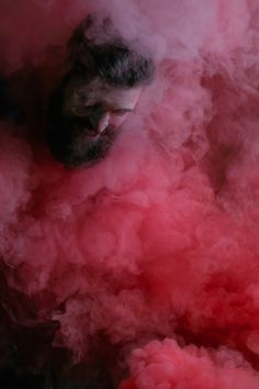 Nate Vaughan Photography - SMOKE - male model in the woods with red smoke bombs.