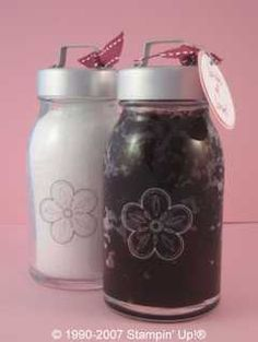 Yummy Hot Chocolate Sugar Scrub Recipe:  3 tbs of cocoa powder, 1 c of light brown sugar, 1 tsp of vanilla extract, about 1/2 c of oil of your choice.  Mix the first 3 ingredients together in a bowl. Then start adding the oil gradually, mixing as you go, until you get the consistency of a thick paste