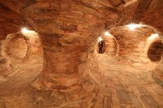 A giant twisted knot of wooden tunnels weave through a huge gallery space in São Paulo   Creative Boom