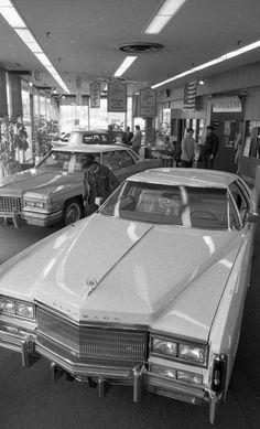 1977 Cadillac Eldorado in Dealer showroom. Note the one leftover 76 Sedan.