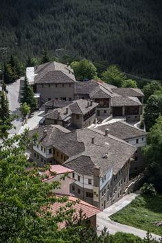 Located in Metsovo, on the edge of the village, is fully equipped for winemaking and bottling. In its cellars lie more than oak barrels, where red wine matures, while in the wine shop are available rare collectible bottles of vintage wines. The Wine Shop, Vintage Wine, Wines, Red Wine, Greece, Castle, Cabin, Mansions, House Styles