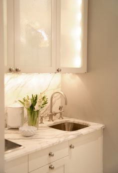 Backlit cabinets! Yes,mercury glass! Would it be easy enough to replace, though?