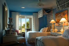Deep Blue Seas  With an ocean-blue ceiling and walls, this breezy kids' bedroom takes after the 2008 Dream Home's Florida Keys location. Blue and white stripes in the bedskirt, wicker chairs, flowing canopy and curtains add a playful pattern and break up all the solids. Snapper Pinky Cotton Candy, a painting