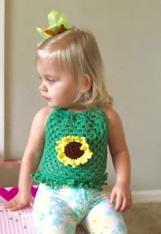 A personal favorite from my Etsy shop https://www.etsy.com/listing/462612727/sunflower-halter-little-girls-tops