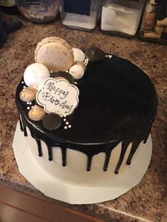 Drip Cake for Birthday. Chocolate with a coffee Macaron and meringues  Niki Diggs Cakes & Catering! (575) 621-5111  ~ El Paso TX and Las Cruces NM ~ https://www.facebook.com/nikidiggscakesandcatering/