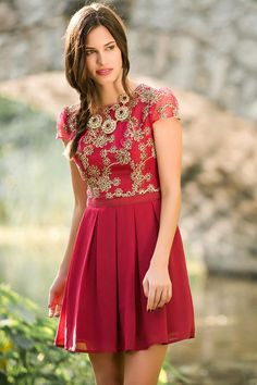 """Wear+the+majestic+Jun+&+Ivy+Floral+Pleated+Dress+to+any+fall+soiree+this+season.+Gold+ribbons+create+a+floral+pattern+on+this+pretty+berry+dress+finished+with+pleats+&+cap+sleeves.+Style+with+a+gold+statement+necklace+&+heels+for+any+special+occasion,<br+/>  <br+/>  -+33""""+length+from+shoulder+to+hem<br+/>  -+34""""+chest<br+/>  -+28""""+waist<br+/>  -+76""""+sweep<br+/>  -+Measured+from+a+size+small<br+/>  <br+/>  -+100%+Polyester<br+/>  -+Hand+Wash<br+/>  -+Imported"""