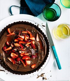 """""""No need to turn the oven on for this lush dark chocolate and strawberry tart dessert,"""" says Curtis Stone. """"The chocolate crumb crust is filled a silky chocolate custard and topped with strawberries, then all you need to do is chill. Tart Recipes, Chef Recipes, Dessert Recipes, Sweet Recipes, Chocolate Custard, Chocolate Desserts, Delicious Chocolate, Strawberry Tart, Strawberry Recipes"""
