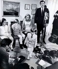 hellyeahteddykennedy:  June 1970 announcing his plans to run for re-election to the Senate….. while little 2 year old son Patrick could really care less.