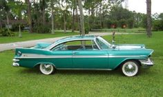 1959_plymouth_sports_fury_lg.jpg  Stepdad had one of these, & THREE 1955 Chevy Belair in turquoise, yellow and red!