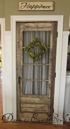 Salvaged Door - this door is used as a pantry door in the kitchen. This blog is Down to Earth Style - she uses a lot of salvaged pieces, in very creative ways, to decorate her home!