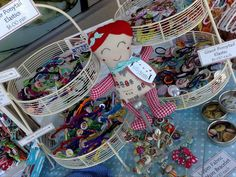 Tiered baskets to display hair clips