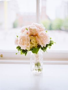 A beautifully composed shot of the bridal bouquet in a mason jar | Steven Wallace Photo