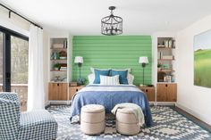 A space with lots of natural light, the beautiful master bedroom at DIY Network Ultimate Retreat 2017 has an apple green custom wall that creates a modern headboard to celebrate the natural vibrancy of the Vermont landscape.