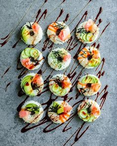 When you can't stop your obsession with donuts, then embrace it! Sushi donuts with pickled ginger, avocado, carrot stripes, chives, nori and sesame, drizzled with vegan ponzu sauce. +  = ✌️ Inspired by @beautifulcuisines. Updated:  Recipe: 4 cups cooked Sushi rice, 1 cup rice wine vinegar, 1/2 cup sugar, 1/4 cup Mirin. Then take out a small handful of rice and stuff it in the donut form. Then carefully turn the donut form upside down, and there are the Sushi donuts. As for toppings, you c...