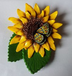 my sunflower brooch with a butterfly