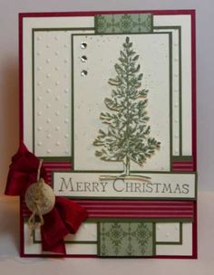 created by Narelle Farrugia Products Used: Cardstock: Always Artichoke, Always Artichoke DSP, Cherry Cobbler DSP, Very Vanilla  Ink: Always Artichoke  Stamp Sets: Lovely As A Tree, Many Merry Messages (retired)  Other Products: Cherry Cobbler Seam Binding, Button, Hemp Twine, Dots Embossing Folder, Basic Rhinestones, Spritzer Tool