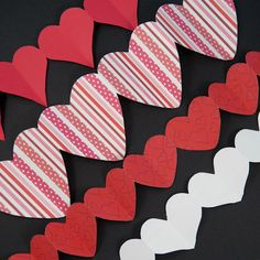 Valentine paper heart chains...What you will make: Create chains of paper hearts by cutting accordion-folded paper strips. You can easily make paper heart chains for Valentine's Day. It's just like cutting Paper Doll Chains—only easier