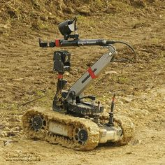 A Dragon Runner Bomb Disposal Robot at a Counter IED (CIED) facility demonstration at RAF Wittering. Improvised Explosive Device, Mobile Robot, Robot Arm, Robot Design, British Army, Military Vehicles, Outdoor Power Equipment, Dragon, Explosions
